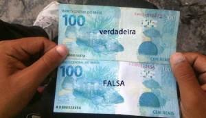 População deve tomar cuidado com notas falsas de R$ 100 e R$ 50 Repassar nota falsa é crime Brasil